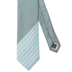 Two-piece necktie sublty combines a fresh blue herringbone pattern with a solid turquoise.