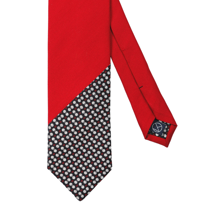 Two-piece necktie with a matt red silk and a playful navy pattern on the tip.