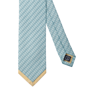 A very crisp necktie with a blue herringbone pattern, finished with a yellow tip.