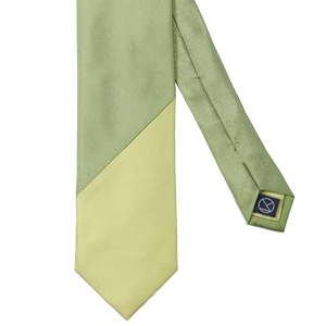 Two-piece necktie combining a two different green hues.