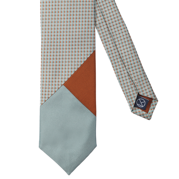 Three-piece tie combining a color palette of browns and turquoise.
