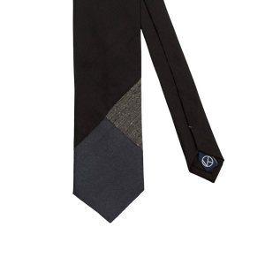 Three-piece tie combining a main black part with shades of gray and blueish gray.