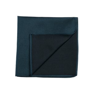 A bright blue pocket square, made of an elegant silk saglietta.
