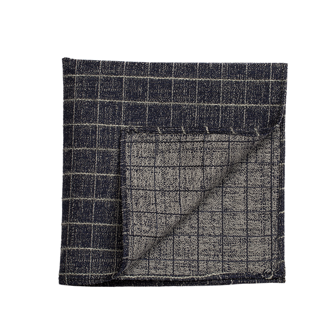A warm gridded pocket square, perfect to add the right amount of coolness to any outfit.