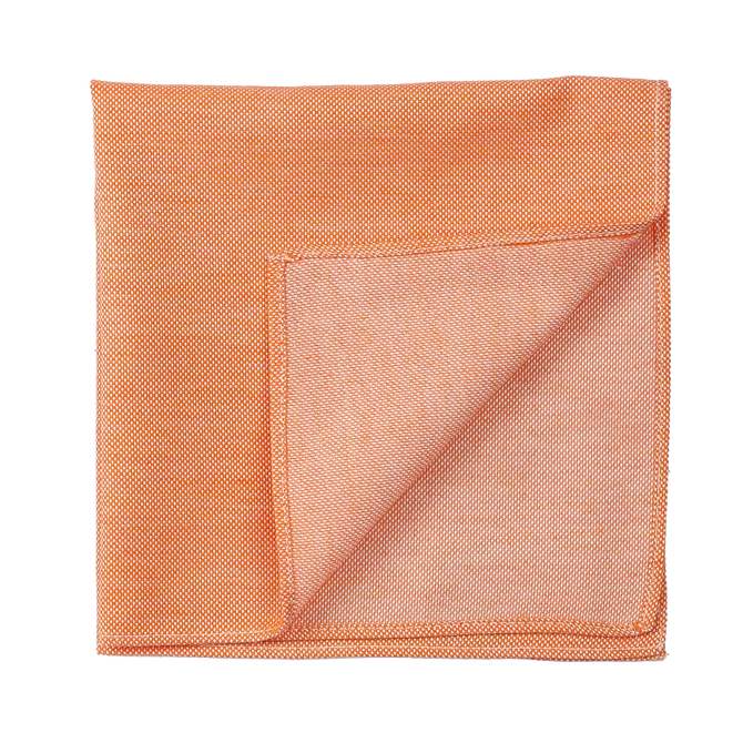 A warm orange pocket square, to freshen up any outfit.