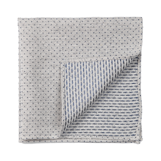 A stylish gray pocket square with navy mini polka dots.