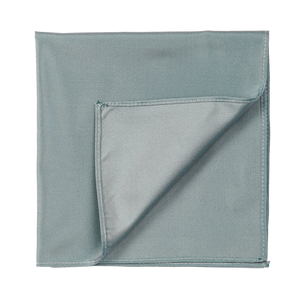 A silky deep turquoise pocket square, a bit iridescent.