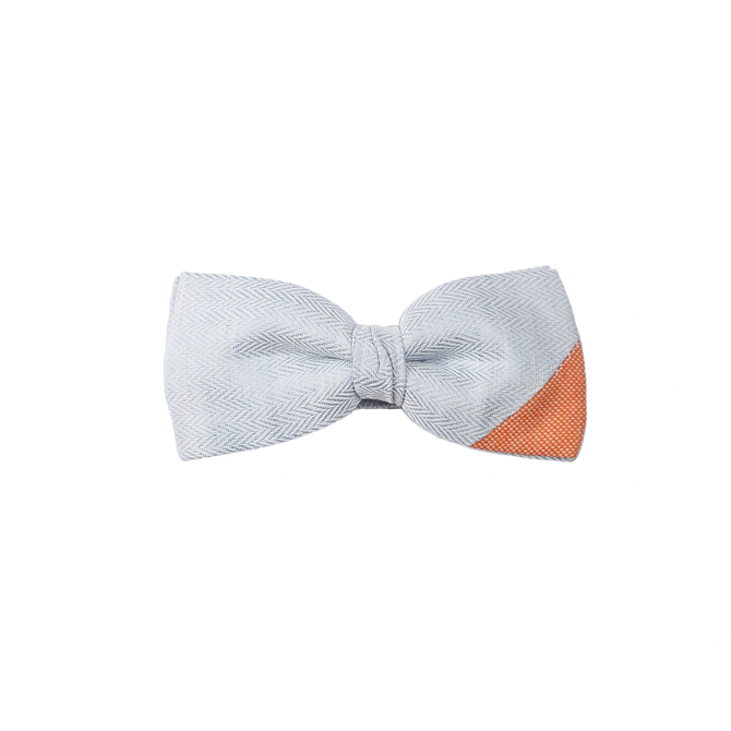 The light blue herringbone matches perfectly with the orange on the tip, making it quite a statement tie.