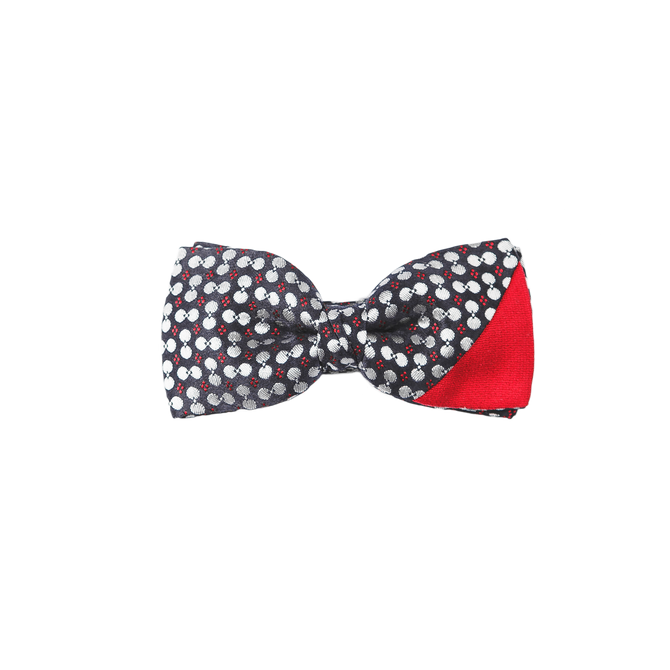 Pre-tied bowtie combining a playful yet elegant patterned dark navy fabric with a matt red silk on the corner.