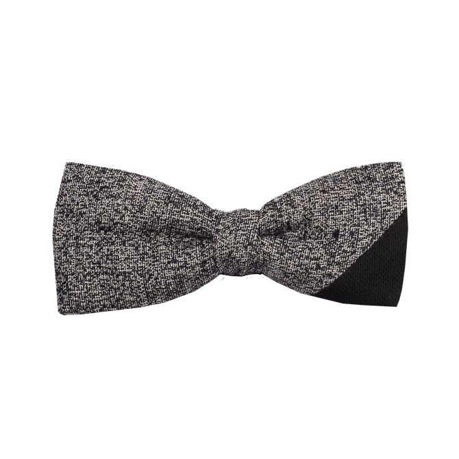 A very minimal black and white necktie with a black corner on the lower right side.