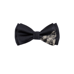 Two-piece bowtie with a navy saglietta and a flowered silver and navy pattern on the lower right corner.