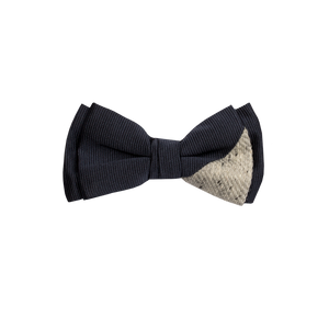 Two-piece bowtie combining a navy main part with a light gray on the lower right side.