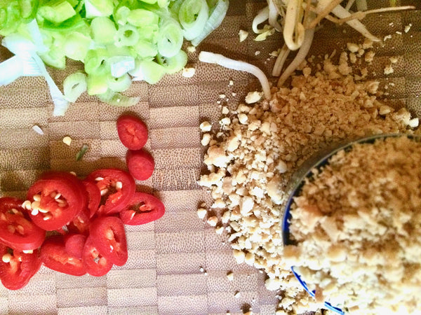 Vegan Pad Thai - Chili, Chopped Peatnuts and sprouts.