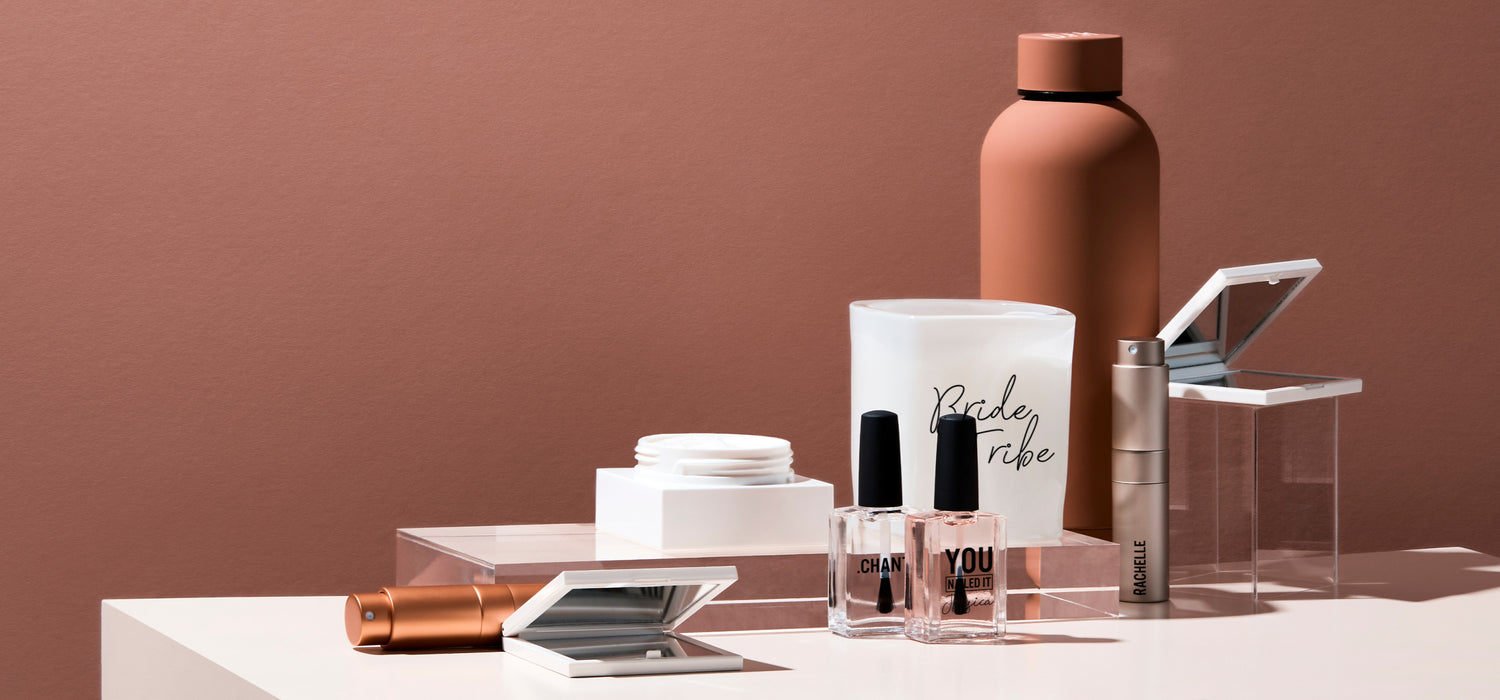 beauty and lifestyle products by Beysis, personalised and arranged on a plinth with a terracotta background