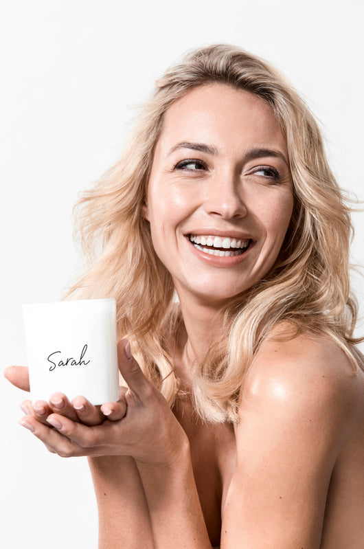 blonde model with personalised name candle for her