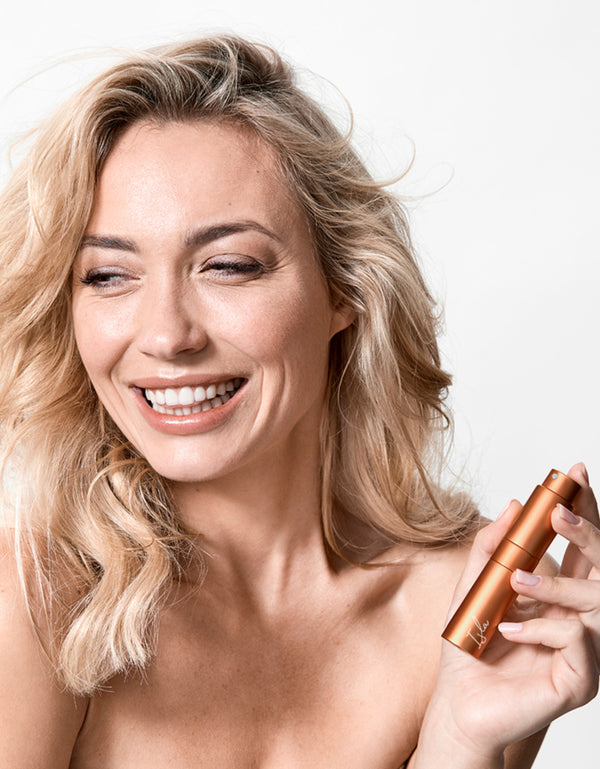 young blonde woman holding a terracotta perfume atomiser