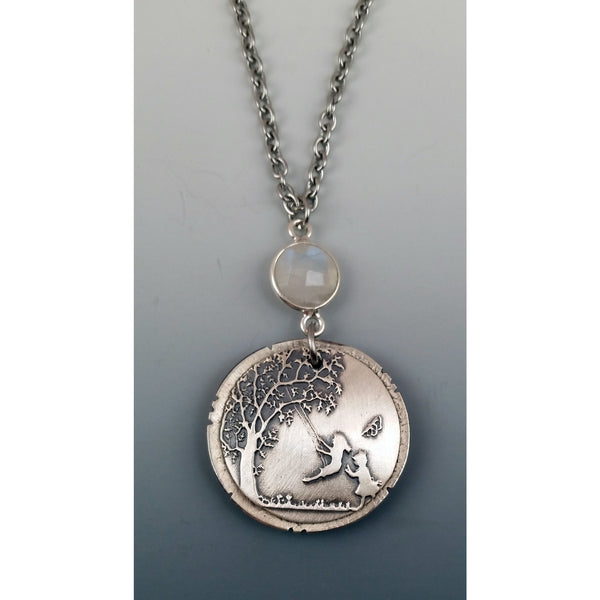 Dreaming Tree-2---Large Locket---shown with rainbow moonstone faceted gemstone.
