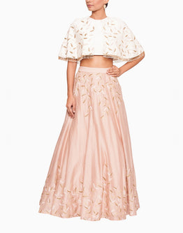 Off White Cape Blouse and Embroidered  Blush Pink Lehenga