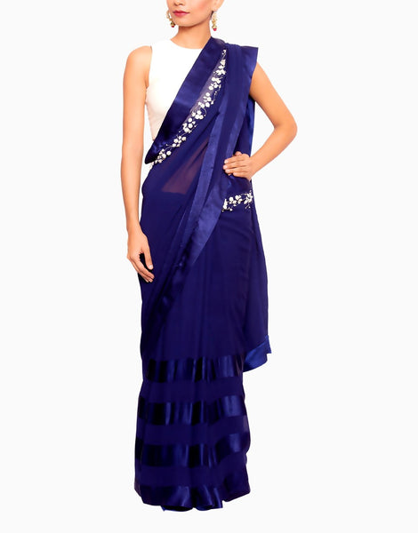 A blue saree paired with cutsleeve blouse
