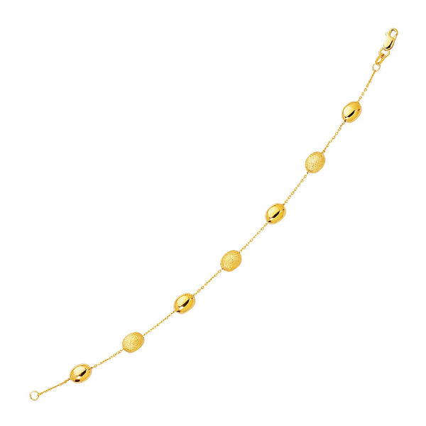 14K Yellow Gold Bracelet with Textured and Polished Pebble Stations