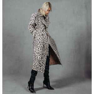 Luxury Leopard Elevate your look with this chic wrap style coat. An outerwear essential. 48' length Kimono sleeves and large notch collar