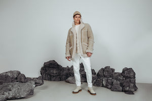 Cement Colour. Shearling. Fits true to size, Reversible. Comfortable fit in the shoulders and chest, straight cut through the torso when worn wool in. Looser fit in the shoulders, chest and torso when worn wool out. , Reversible, Notch lapel, Interior zipper pockets, 31 in