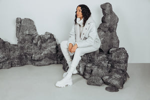 WHITE GLOSSY CURLY. Shearling. Reversible. Dropped shoulder and loose sleeves. Designed for a loose fit through frame with a boxy cut. Styled after the French bleu de travail or Chore jacket. 26 in
