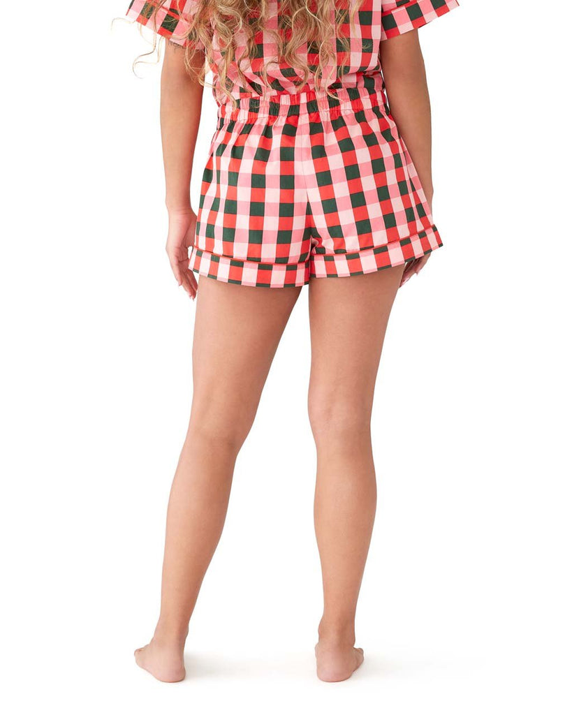 Back shot of green & pink plaid pajama shorts with a pink tie.