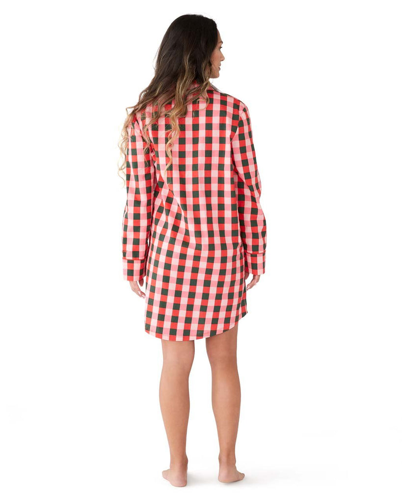 Back shot of woman in a long sleeve green & pink plaid pajama dress.