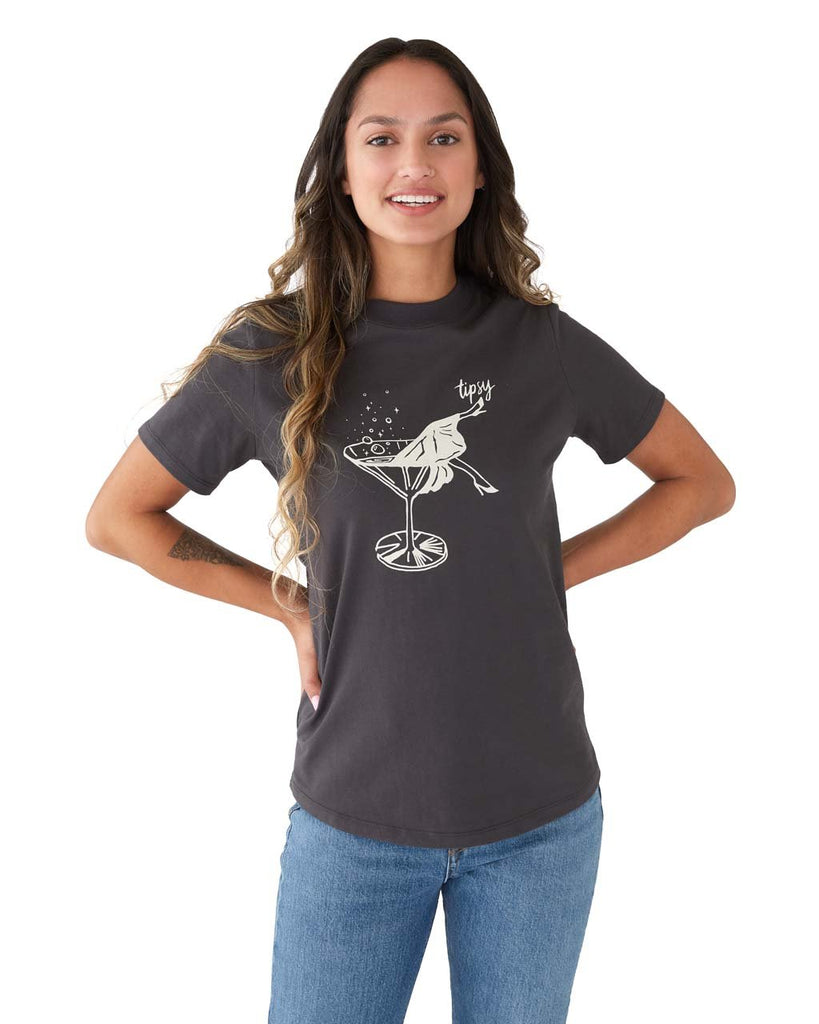 "Woman in a vintage black short sleeve tshirt with a white graphic of legs in a martini glass and the words ""Tipsy"""