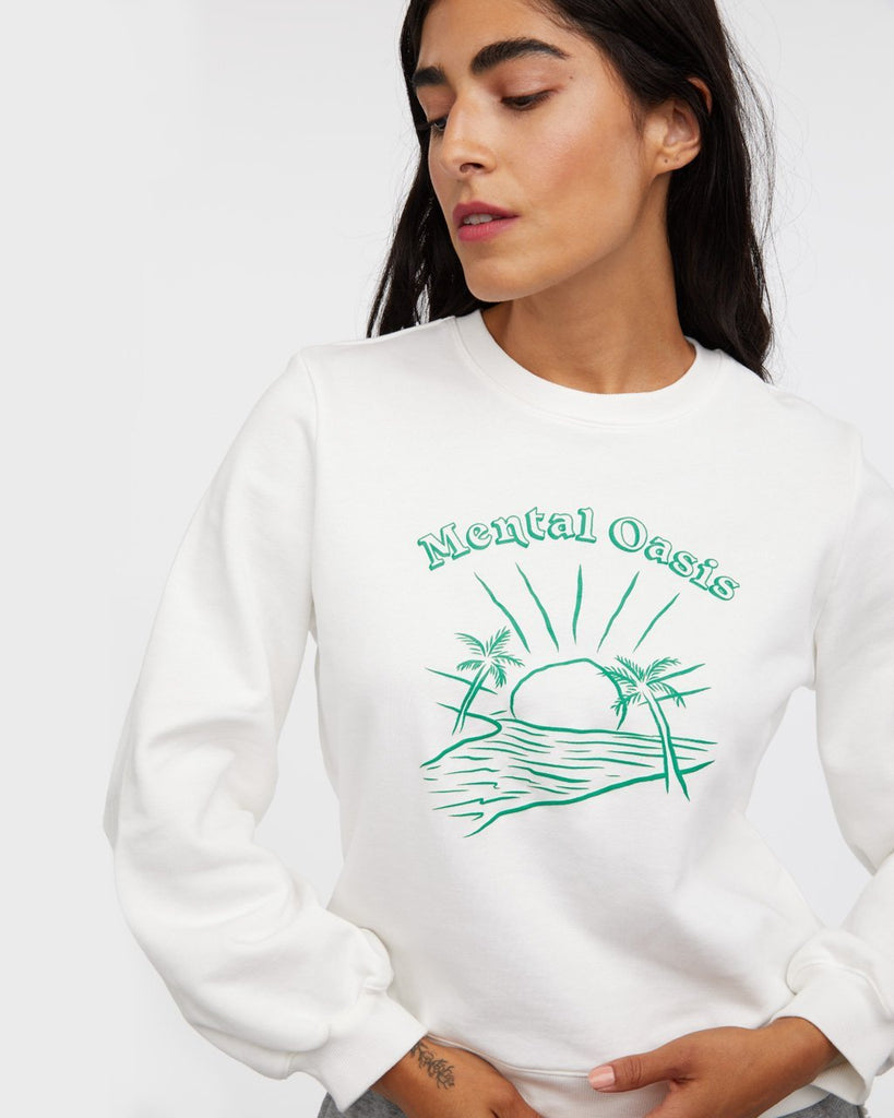 White balloon sleeve sweatshirt with design shown on model