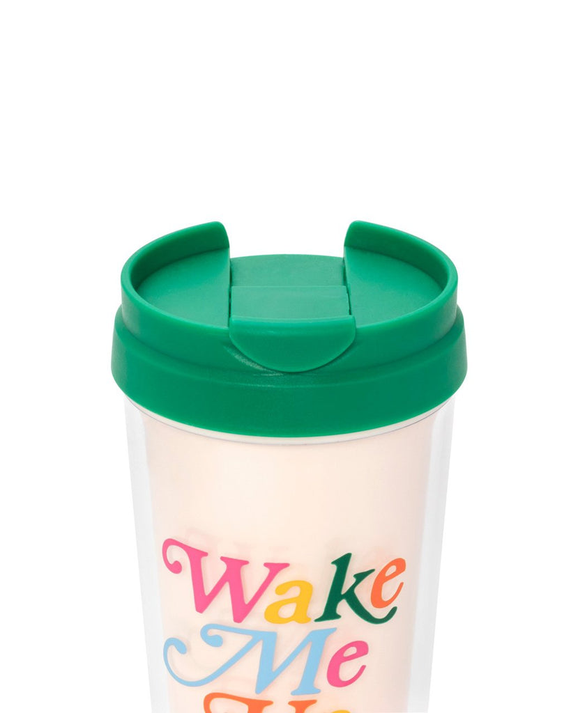 cream thermal mug with a green spill proof lid