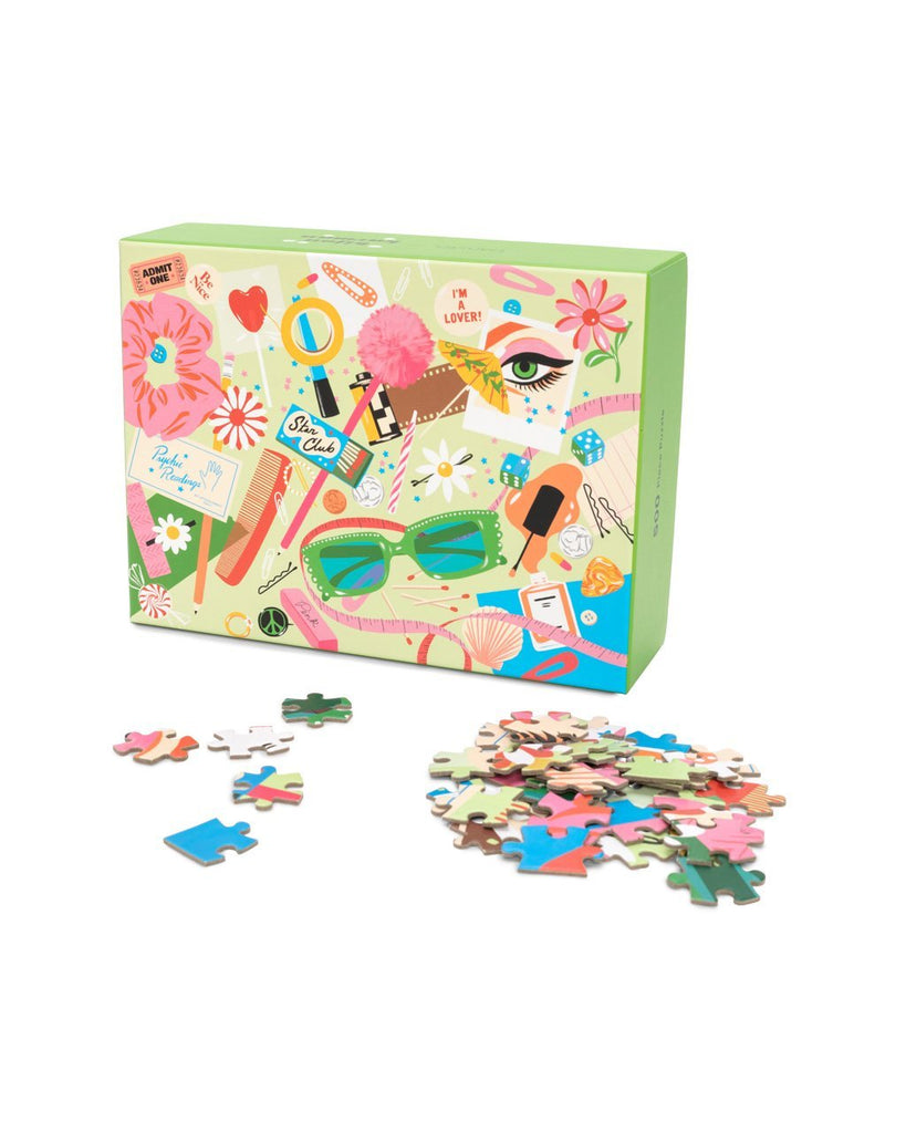 image of puzzle pieces shown outside of box packaging