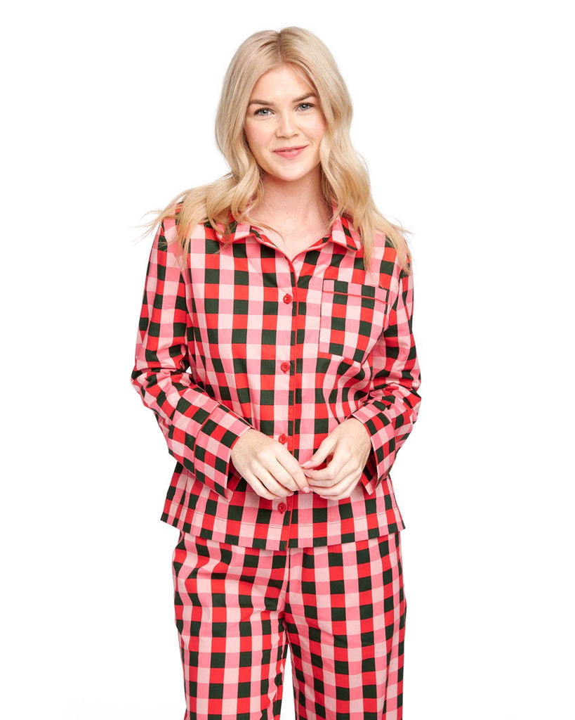 Woman in a long sleeve green & pink plaid pajama top.