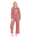 Woman in green & pink plaid pajama pants with a pink tie and matching long sleeve pajama top.