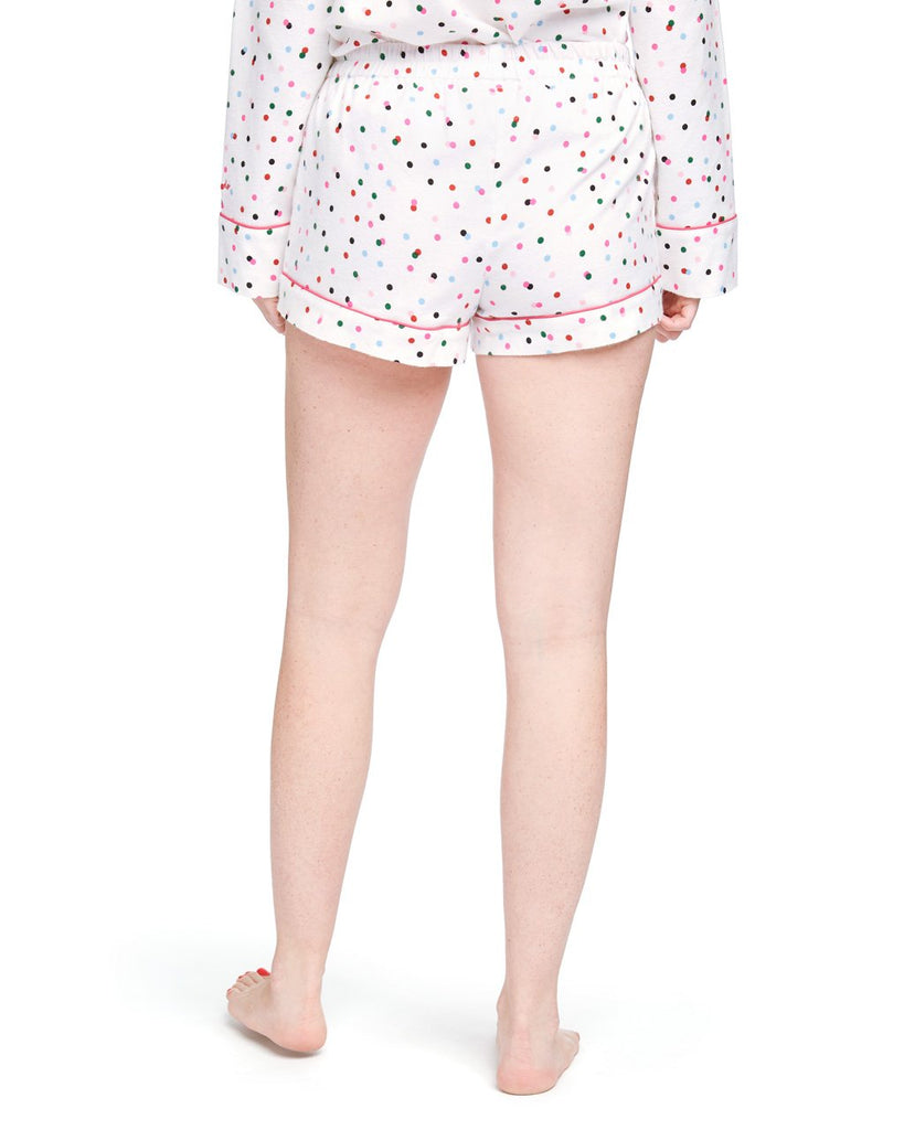 Back shot of flannel pajama shorts with allover multi-color polka dot print and pink drawstring tie.