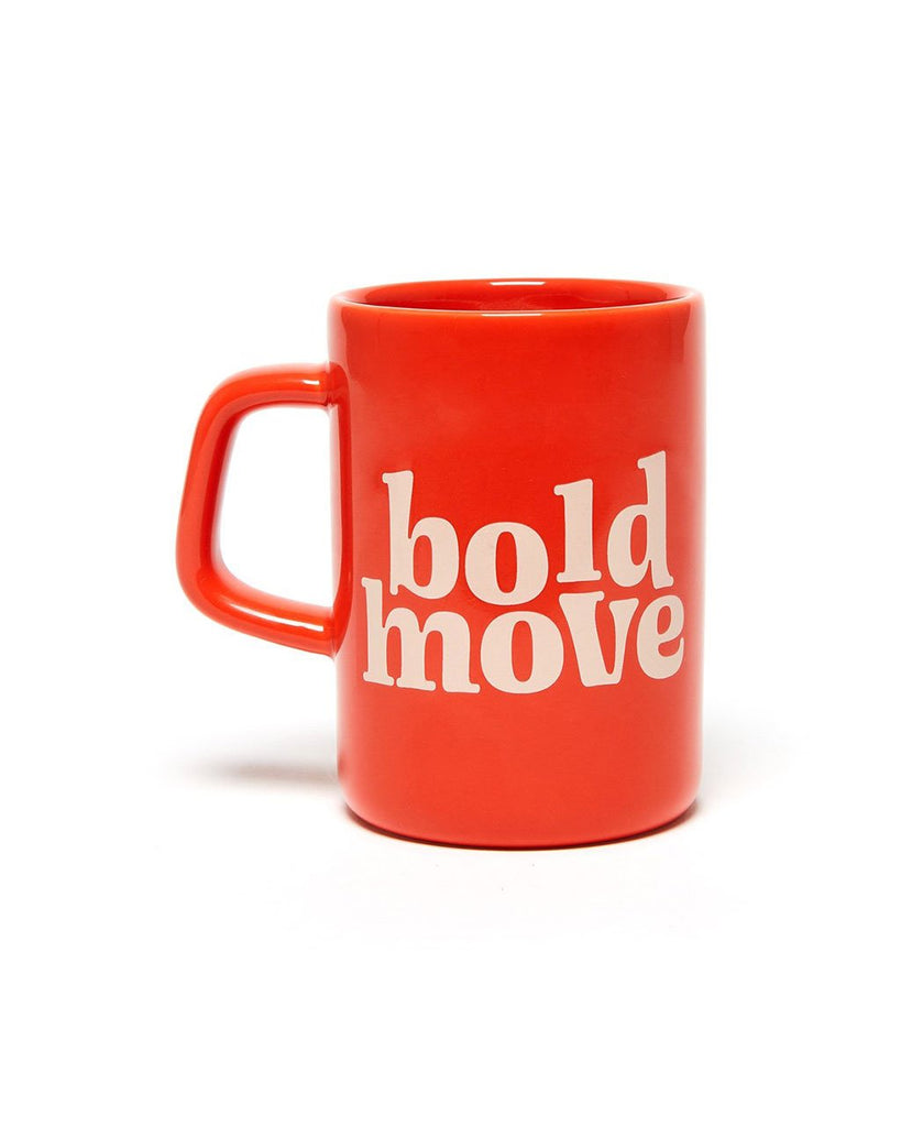 big red ceramic mug with the words bold move