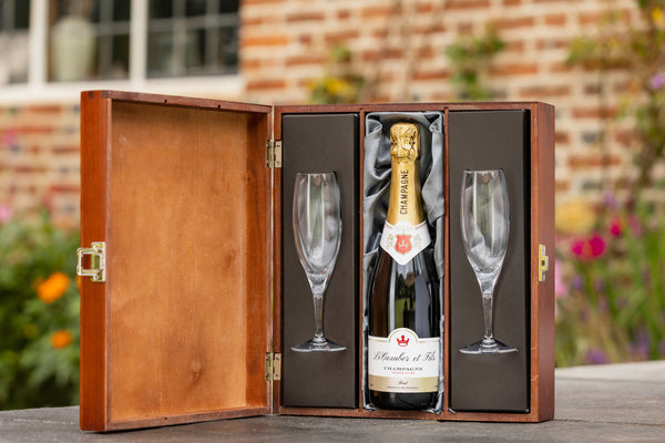 Bottle of corporate branded champagne presented in a luxury wooden gift box with two flutes