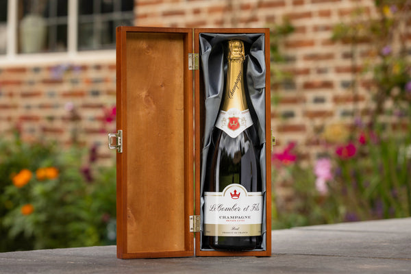 Bottle of personalised champagne presented in a luxury wooden box