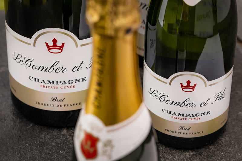 Close up of 3 personalised labels of champagne