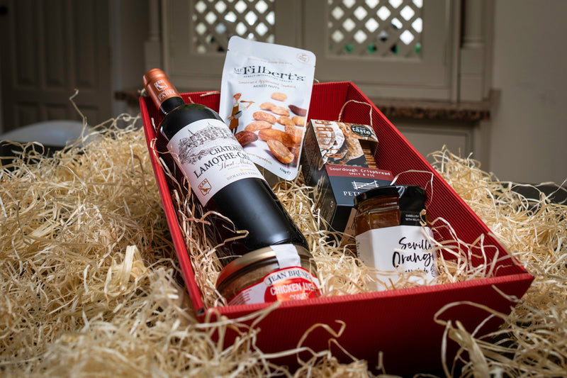 Bottle of wine, chicken liver pate, orange marmalad, crisp bread and mixed nuts all in a hamper | The Gentleman's Half Hour