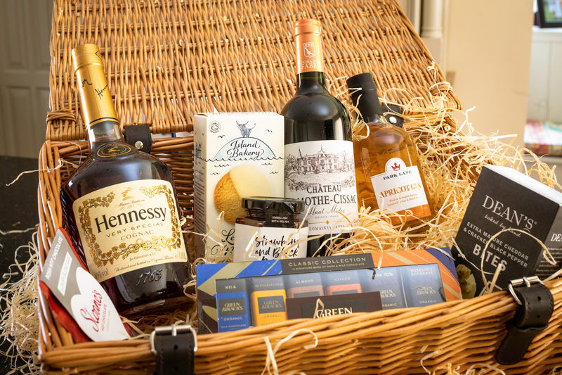 Picnic hamper filled cognac, chateau mothe-cissac, apricot gin, green classic collection, crackerbreads, nuts