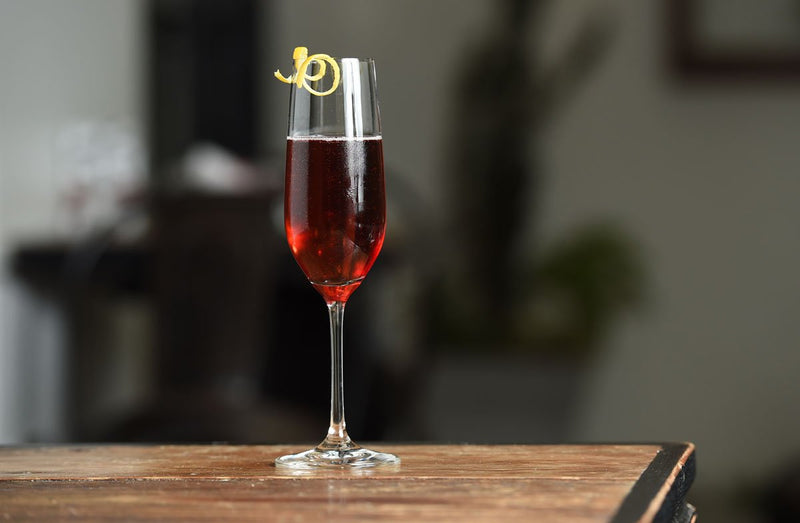 Kir royale in glass with lemon twist