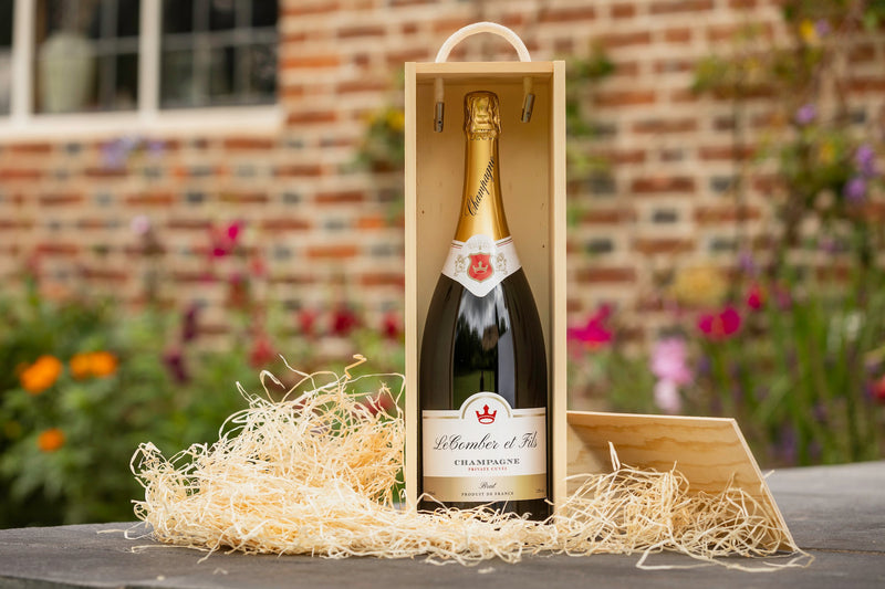Magnum bottle of personalised champagne presented ina  wooden box with rope handle