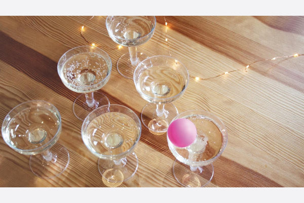 Champagne Pong with champagne glasses