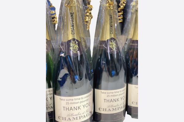 Magnum bottle of corporate branded champagne gift wrapped with card