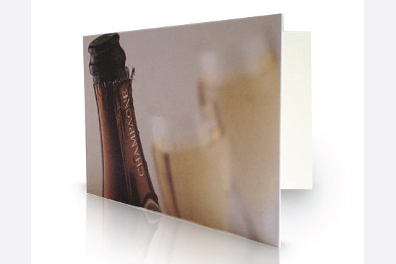 Half bottle of corporate branded champagne gift wrapped with card