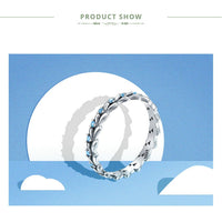 Blue Simulated Diamond Eternity Ring in Grain Style Band