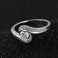 Camille 4mm Round Brilliant Cubic Zirconium Half Bezle Set Swirl Bypass Engagement Ring