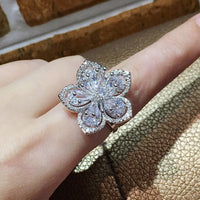 Large Flower Coctail Fashion Ring with Pear Cut Simulated Diamond Center Stones and Round Pave Set Side Stones